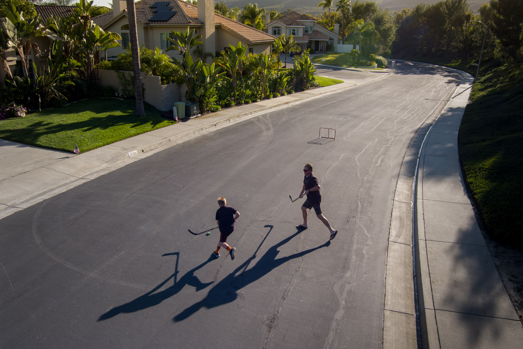 Street hockey father son